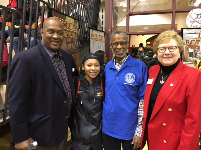 Congressman Dwight Evans, CHC sophomore and basketball player, Mary Trossi, Senator Art Haywood, and Sister Carol Jean Vale, CHC president, pose after the game February 11.