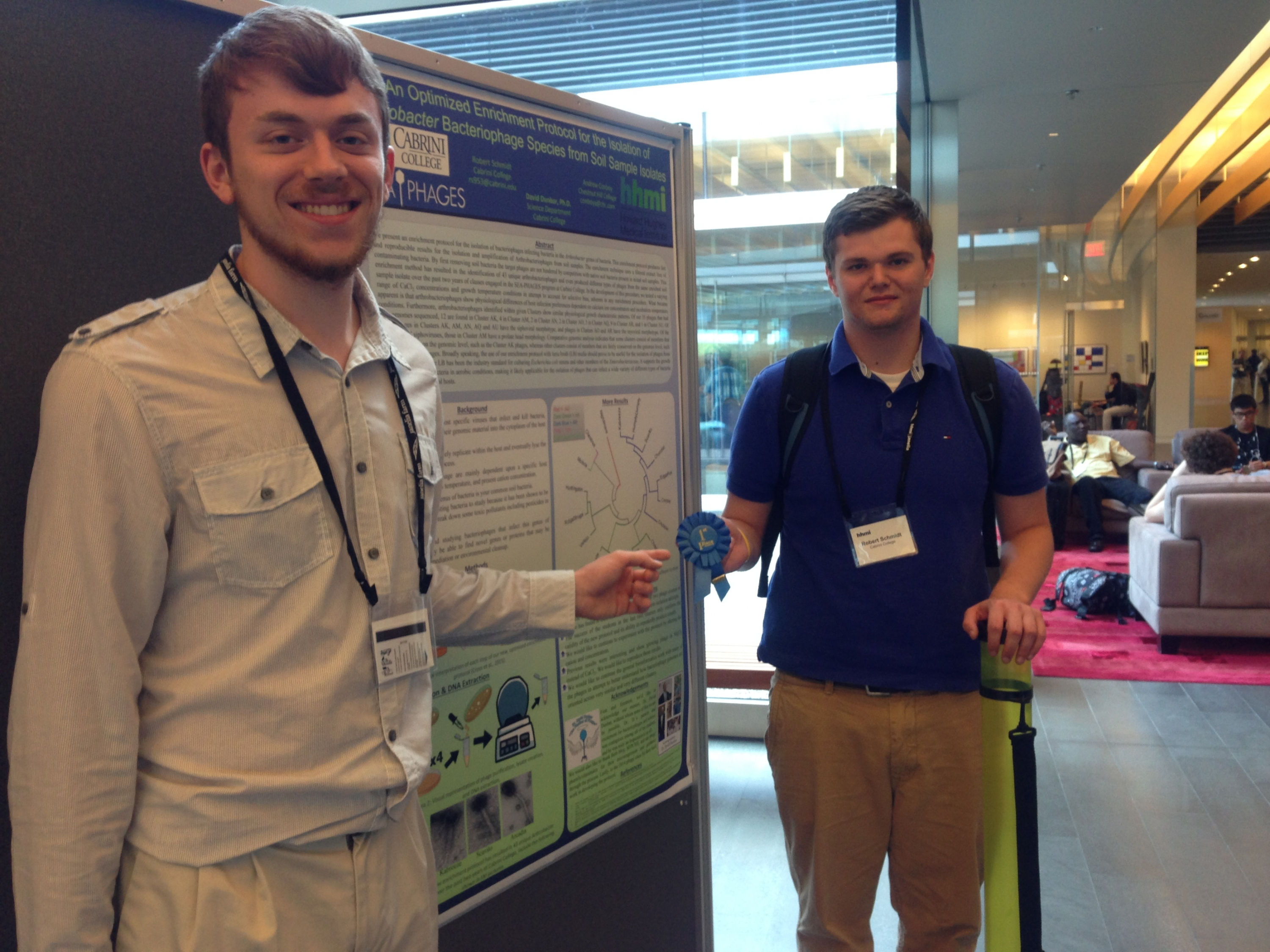 Andrew Conboy '18, left, and Robert Schmidt '17 stand with their winning poster. Photo courtesy of Andrew Conboy '18
