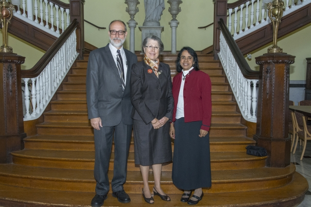 Martin Keszler, M.D., and Mary Lenore Gricoski Keszler, M.D., '74 stand with Lakshmi Atchison, Ph.D., professor of biology and the coordinator of the series, prior to the lecture.