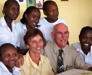 Bud and Sue Ozar '63, founders of Friends of Kenyan Orphans, with some of the kids.