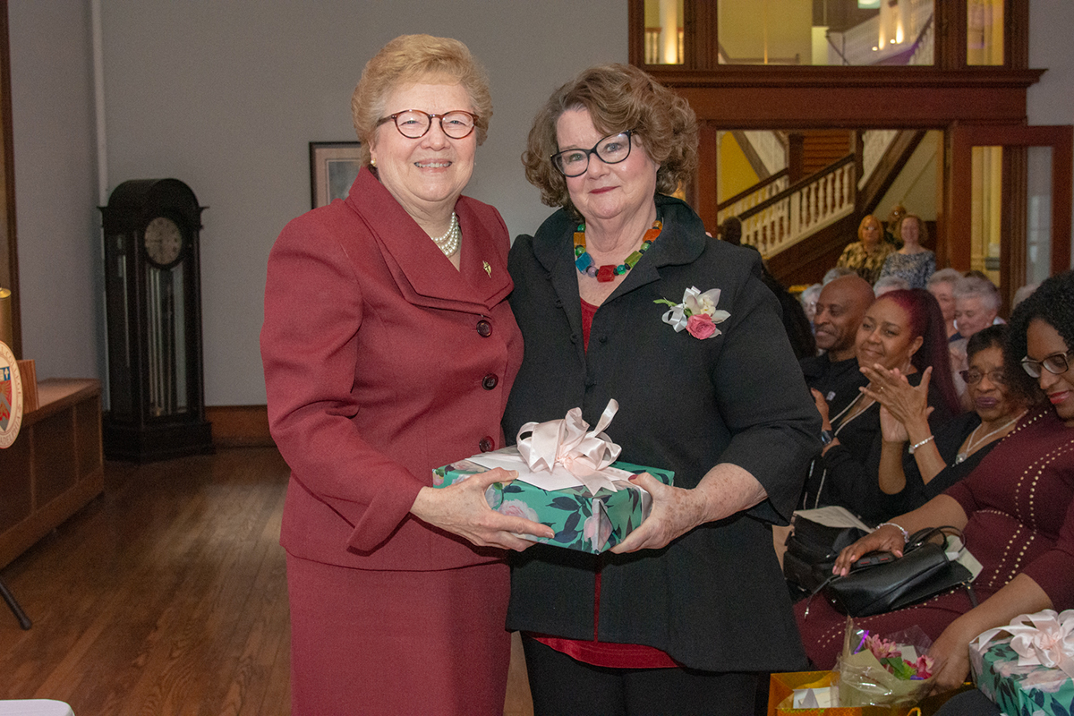 Sister Carol with Sara Kitchen, who is retiring after 34 years of service to the College.
