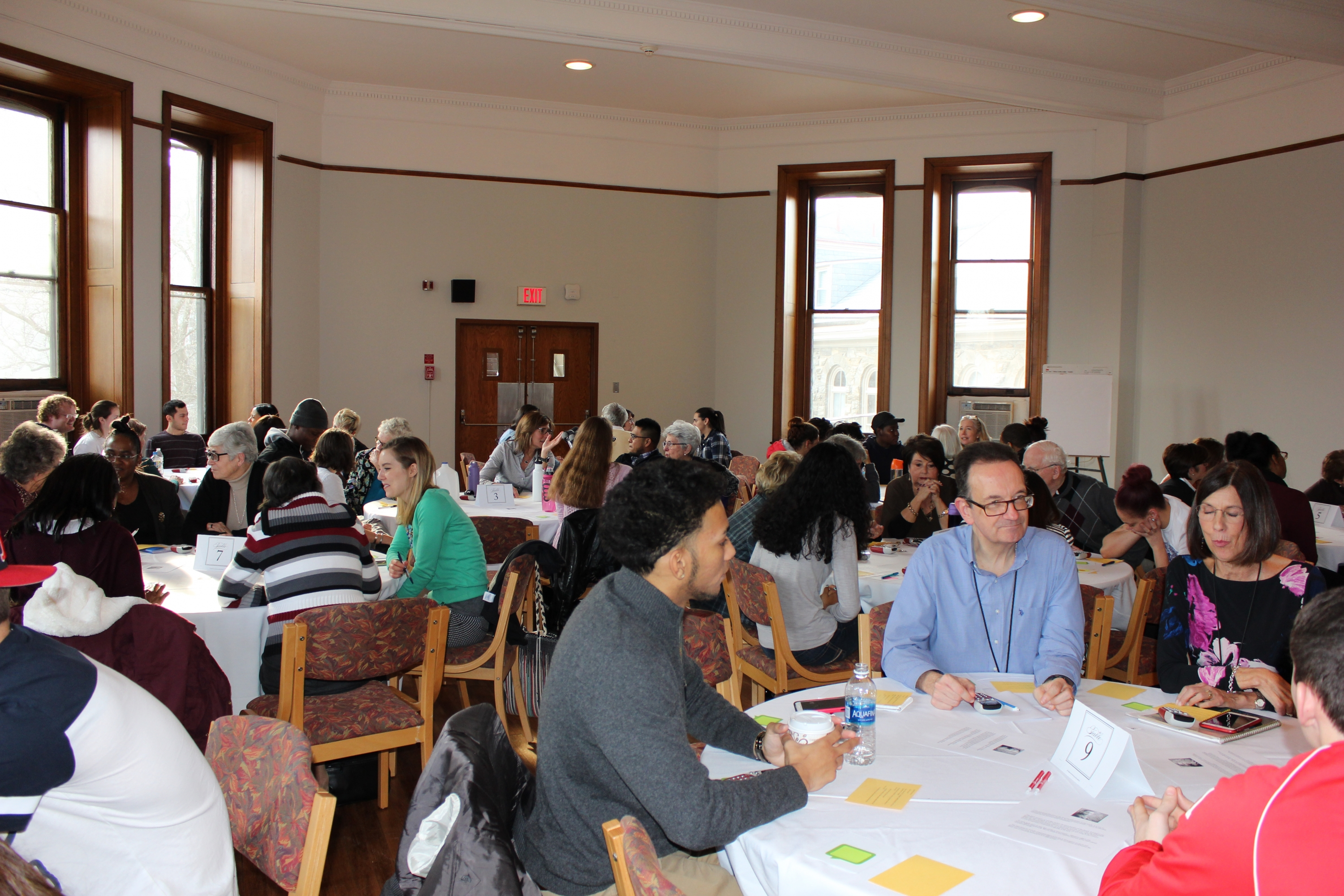 Members of the College community engage in table discussion and shared insights during the MLK Day of Remembrance.