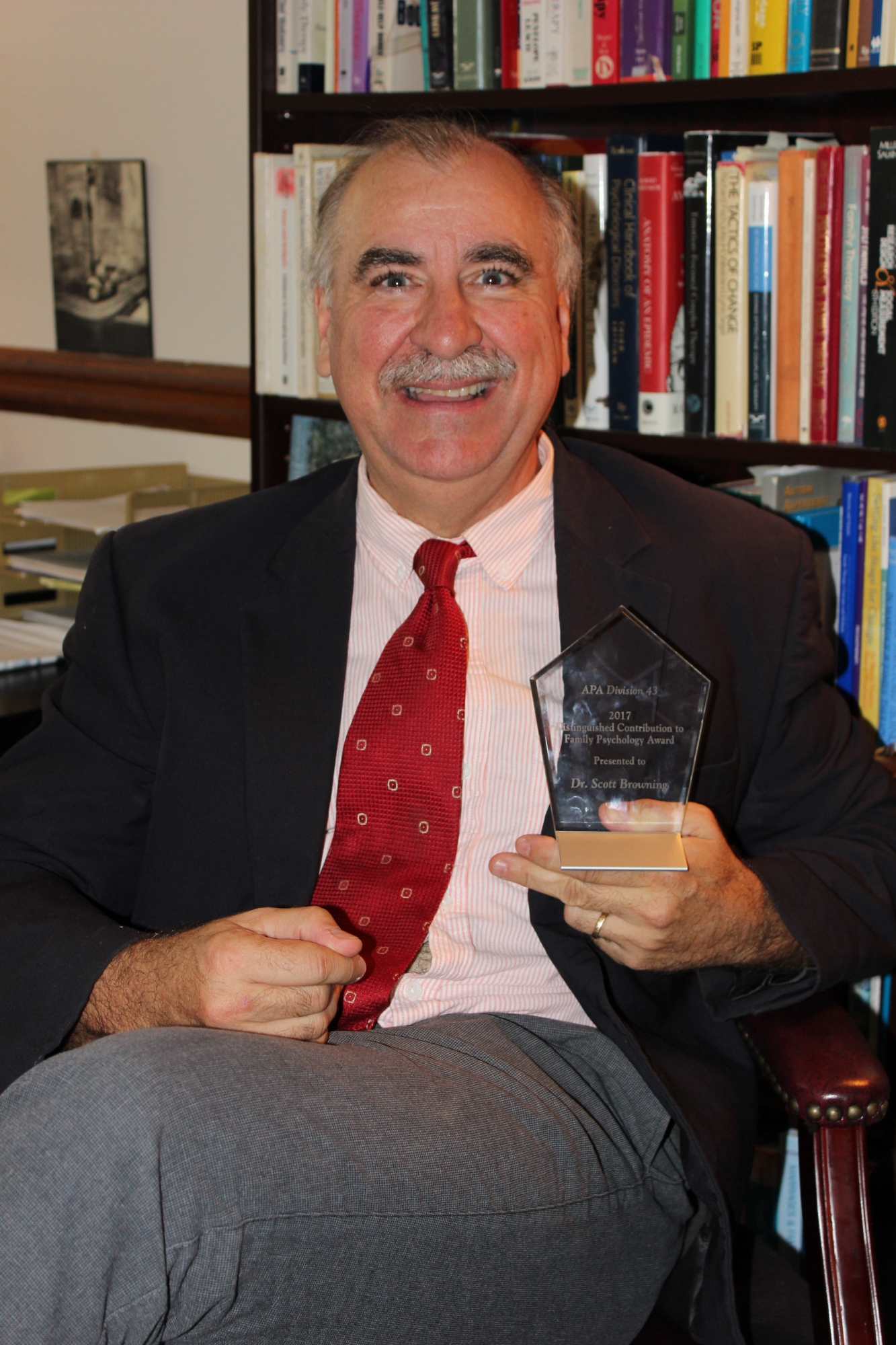 Dr. Browning poses with his award.