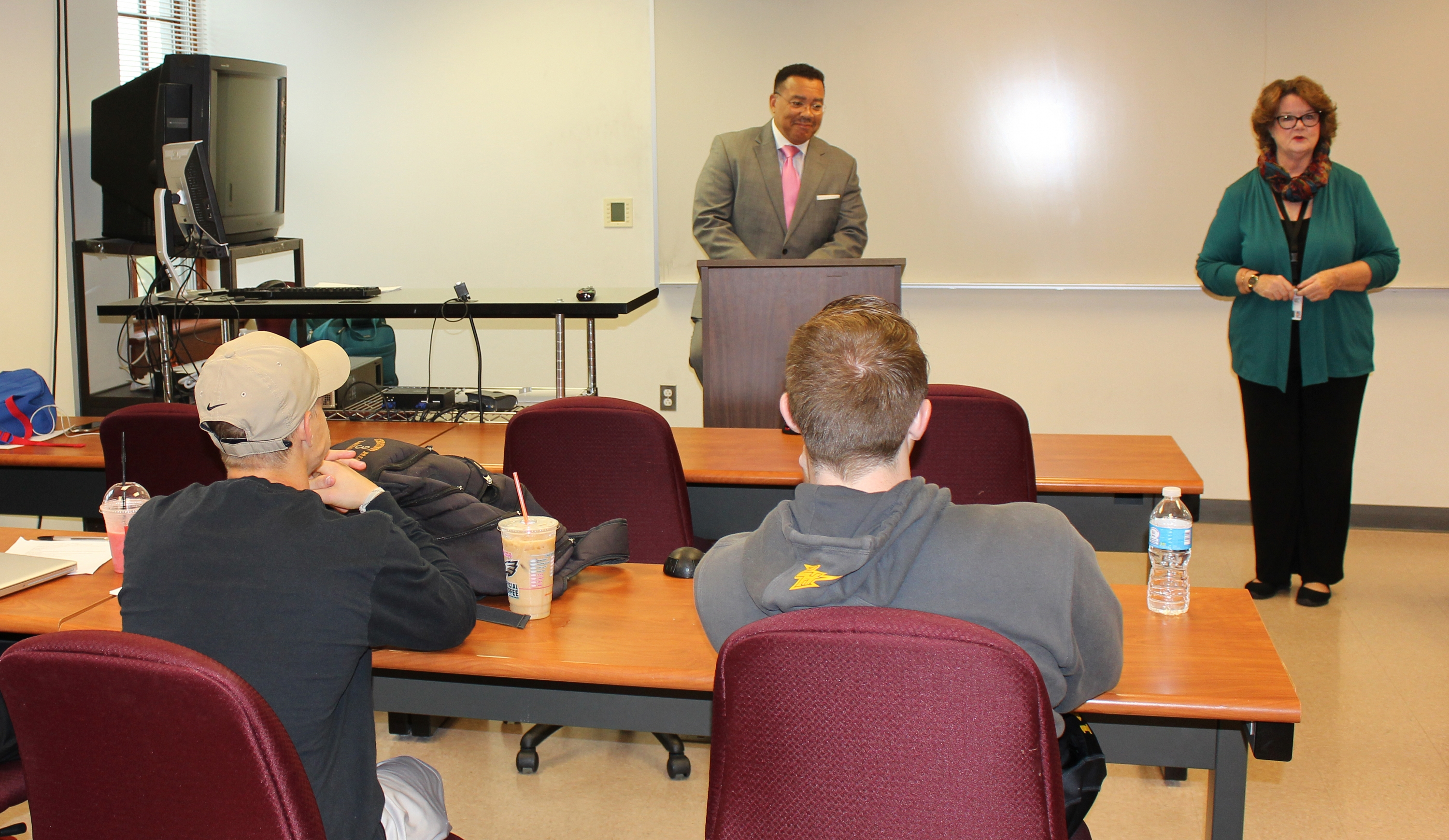 Sara Kitchen, J.D., welcomed Kevin Bethel '08 SCPS before he addressed her criminal justice class. Photo credit: Marilee Gallagher '14