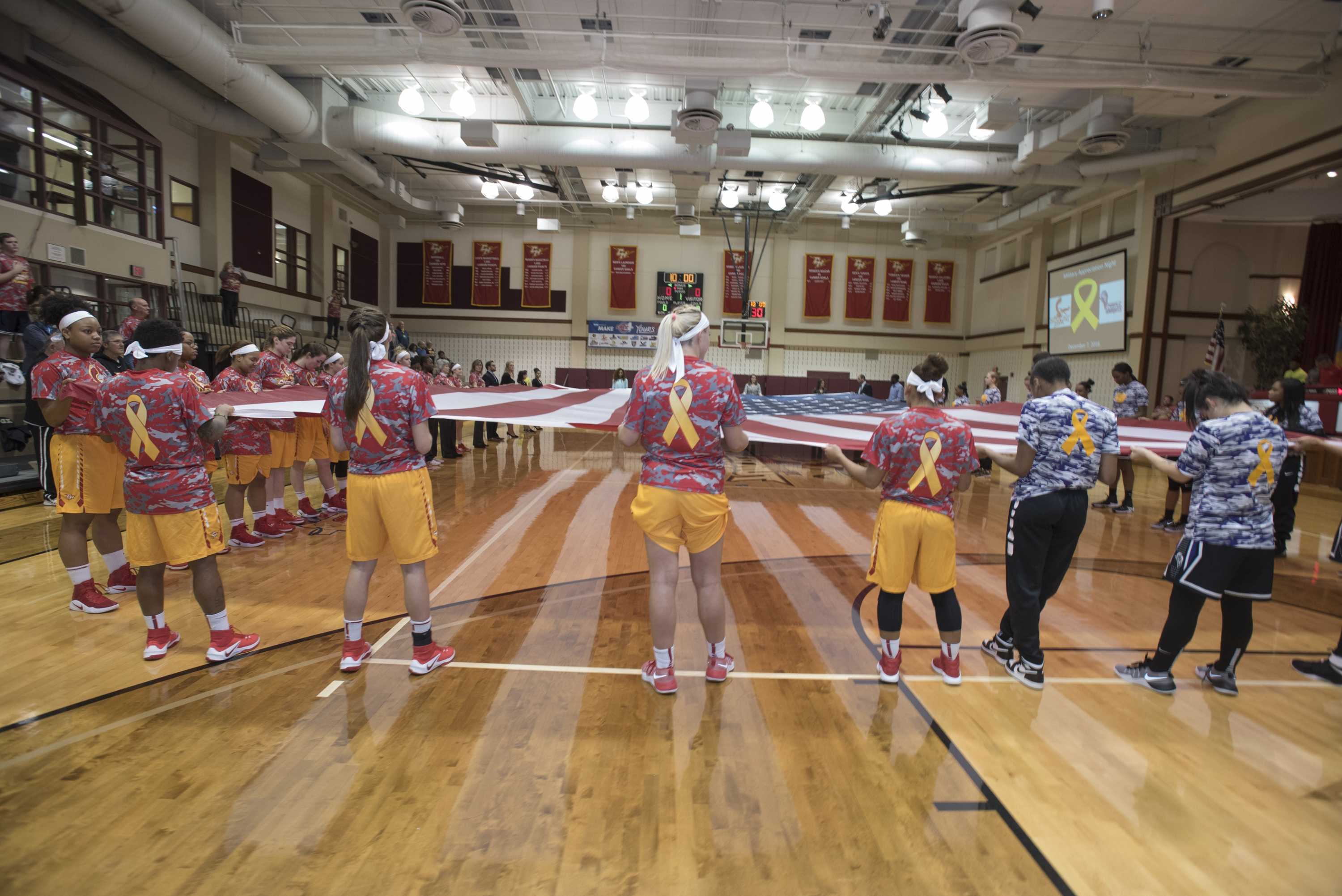 Prior to the game, members of both teams wore camouflage warm-ups and rolled out a court-sized American flag, donated by Metropolitan Flag & Banner.