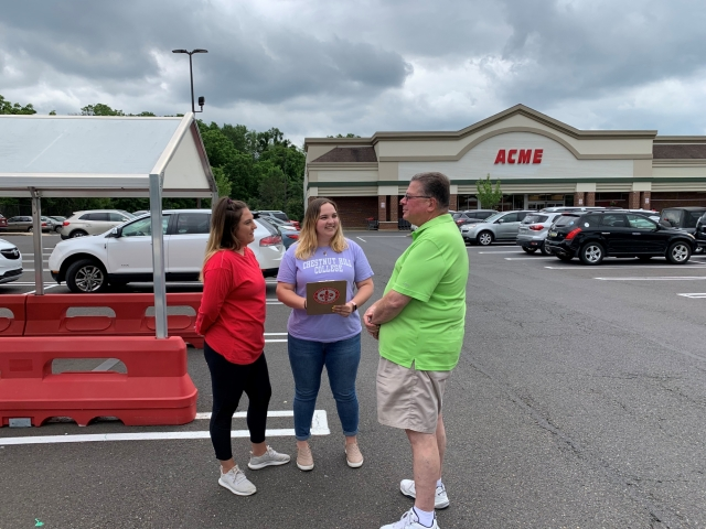 CHC students Lauren Kropp (left) and Kira Altomari surveying citizens at a nearby ACME for their criminal justice class.