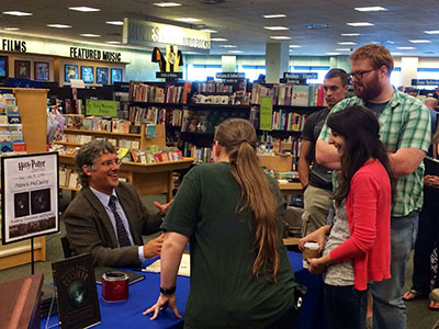 Patrick McCauley, Ph.D., signs copies of his book at a recent appearance.