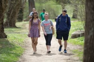 3  students walking in the park