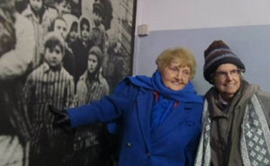 Marie Conn, right, stands with Eva Kor on a visit to Birkenau in Poland.