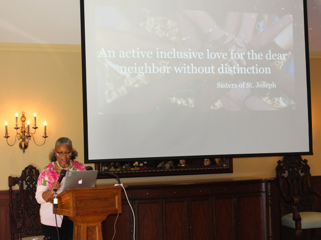 Lisa Johnson, Psy.D. '04, a member of the College's Counseling Center staff, presents at the symposium.