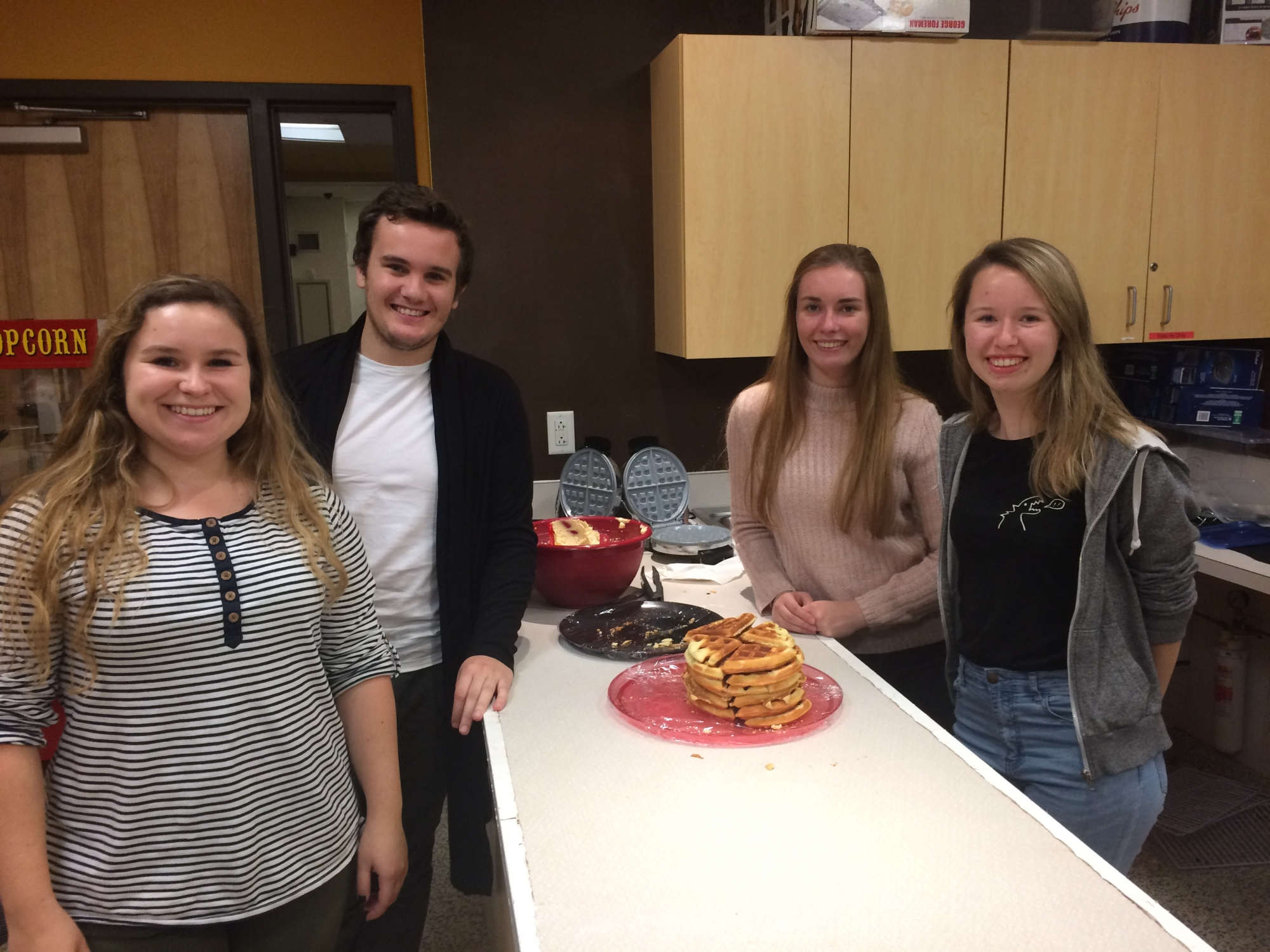 Belgian students Elise Grymonprez, Tijs Toulouse, Eline Vercaemer, Tessa Gesquire prepare delicious waffles based on a recipe from their home country.