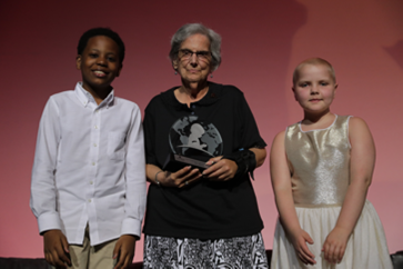 Dr. Conn poses with two young patients after receiving her award.