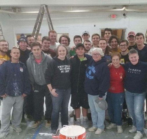 Men's lacrosse took part in the Christus Lutheran Church paint project in Camden.
