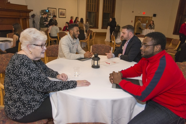 Alumni and students interact during networking night in February.