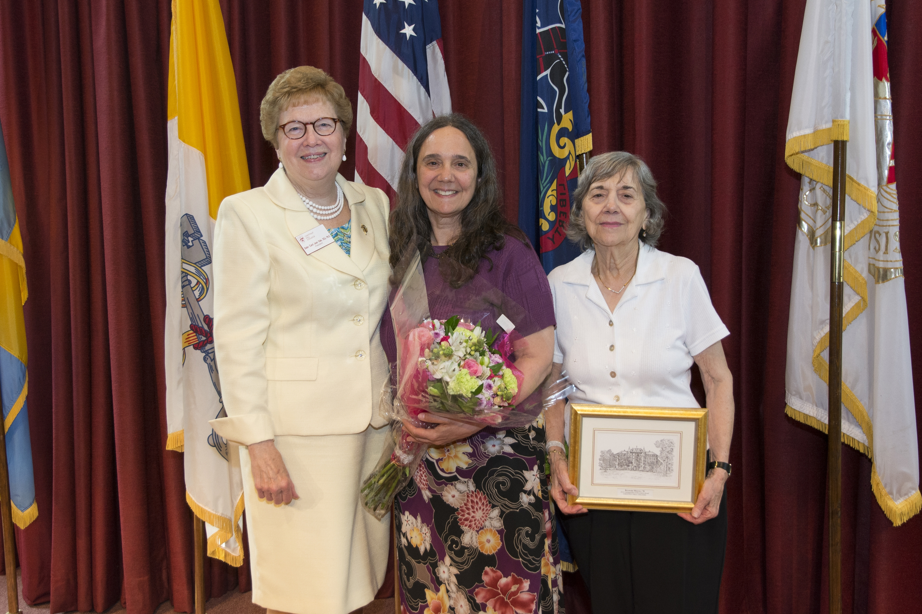 Ritamarie Moscola M.D., M.P.H. '78, center, and her mother pose with Sister Carol after the ceremony.