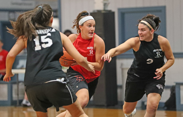 Vicky Tumasz  '18 dribbles past defenders during one of the summer league games.