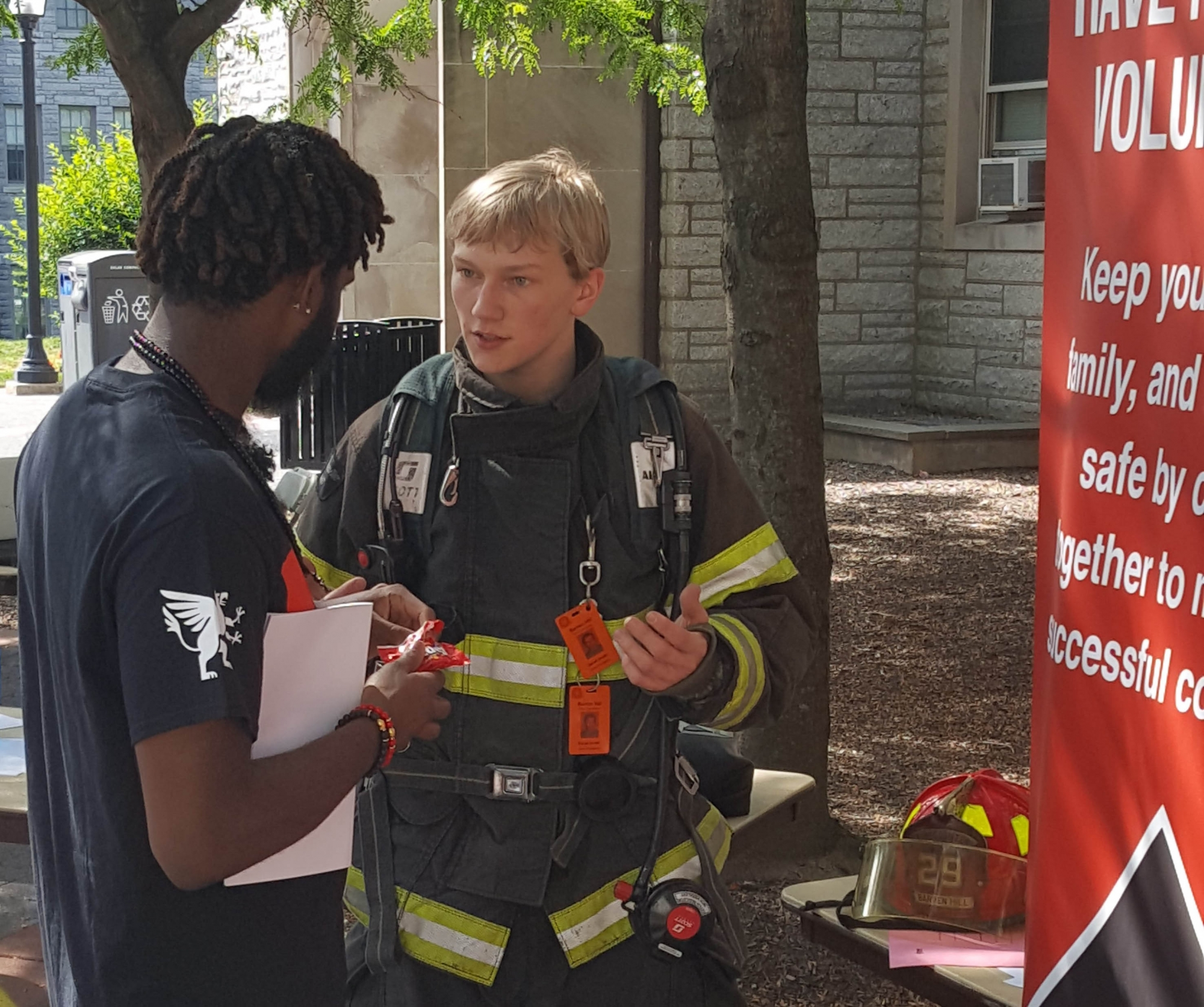 Derek Smith explains the goals of CHC's Firefighting club to a fellow student.