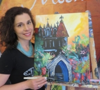Artist with painting of college