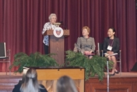 Sister Kathy Duffy opens the conference. Seated next to her are Sister Carol Jean Vale, Ph.D., College president, and Elizabeth Moy, executive director of SEPCHE.