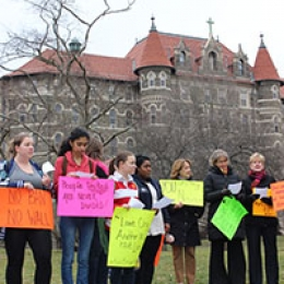 """Members of the College community took part in a global unity march in solidarity with our """"Dear Neighbors"""" throughout the globe."""