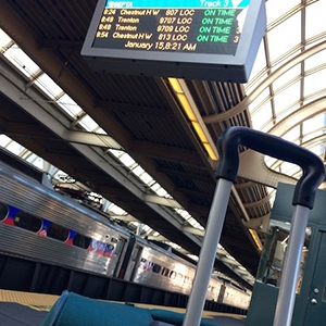 Suitcase, train and timetable