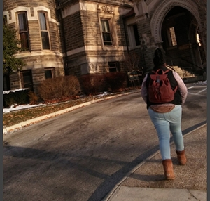 Danielle walking on campus