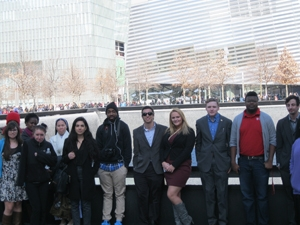 Global Studies students in front of memorial