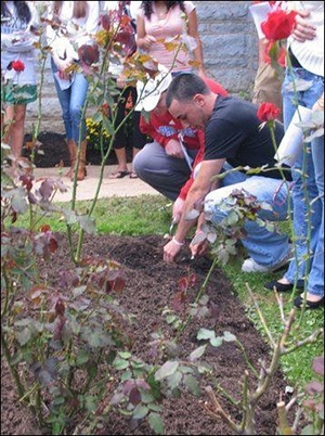 A student planting in the Garden of Forgiveness