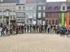 international students ride bikes in Belgium