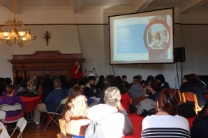 Eighth grade students listen to a presentation about attending CHC.