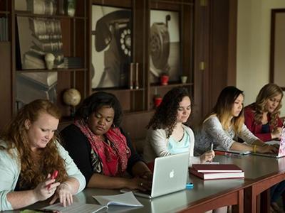 5 women studying