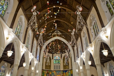 Ceiling of Broad Street Ministry. Ornamental windmills and origami birds are hung as decoration