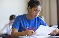 Female student looking at paper