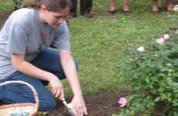 young woman planting in earth