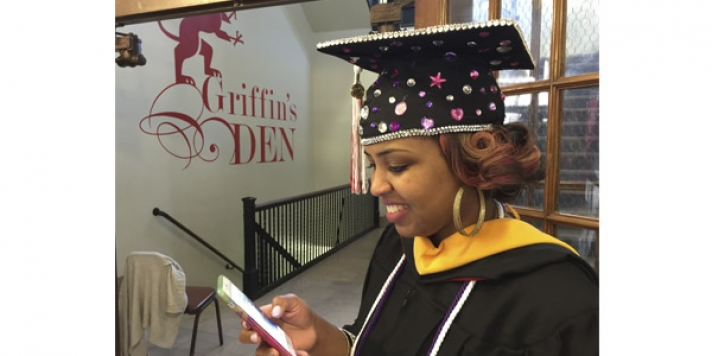 Sparkle mortarboard on graduate who is texting