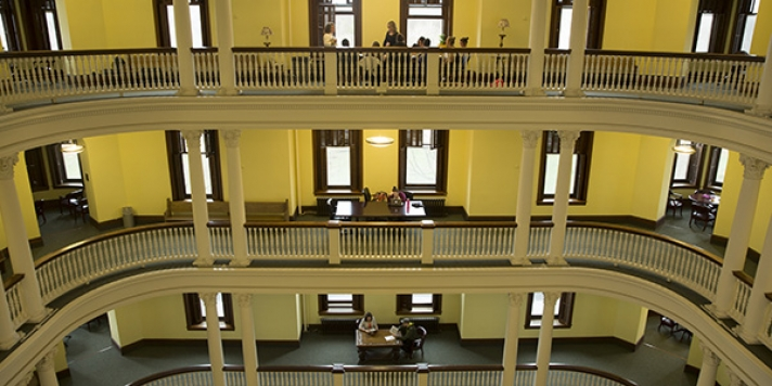 3 levels of the rotunda with sitting at tables on each level
