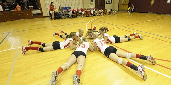 Female volleyball playings planning their next move