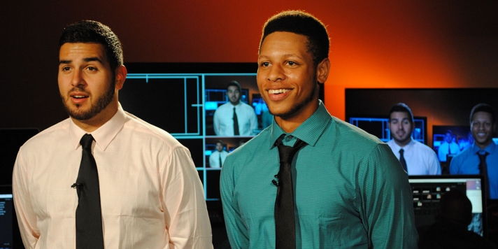 Two student sports broadcasters