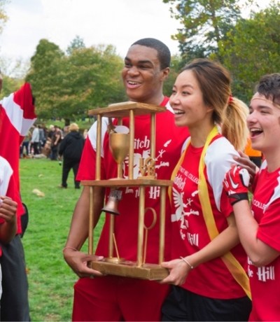 students celebrating quidditch victory with trophy