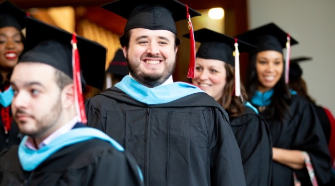 Students in caps and gowns during graduation ceremony