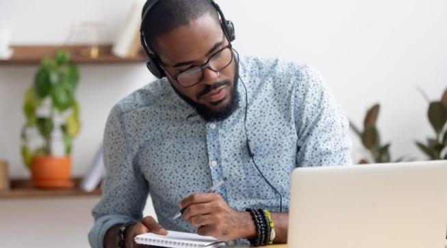 Student wearing headphones working at computer