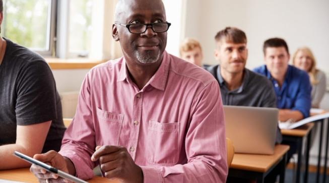 Older man sitting at desk