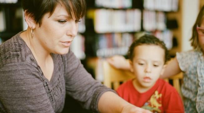 Woman teaching small child