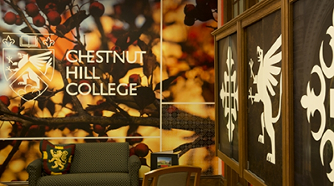Image of Chestnut Hill College logo on wall