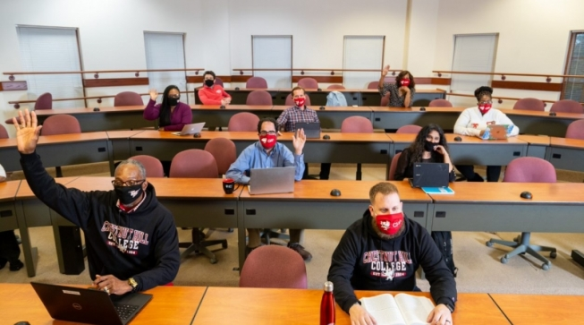 Students in face masked sitting socially distanced in classroom