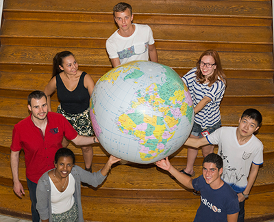 International students holding the globe
