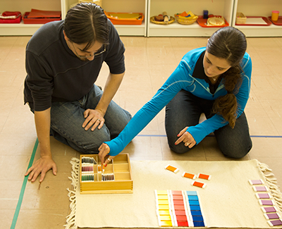 Two students work with blocks