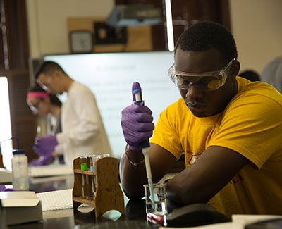 Chemistry student working with test tube