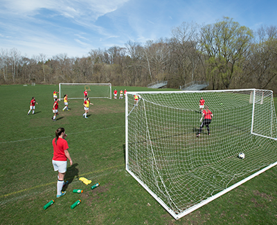 Soccer goal with female athletes