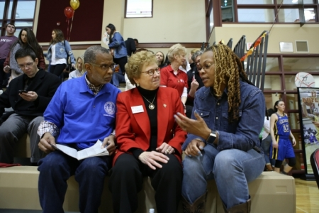 Senator Art Haywood, Sister Carol Jean Vale, CHC president, and Martin Luther King High School Principal, Keisha Wilkins, confer Saturday afternoon.
